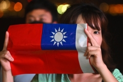 A woman holds a small Taiwanese national flag during a rally in Hong Kong last October. (Photo by Philip Fong/AFP via Getty Images)