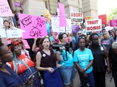 Abortion rights advocates including NARAL Georgia Director Laura Simmons (3rd-L) rally in front of the Georgia State Capitol in Atlanta to protest new restrictions on abortions that have been passed in Georgia, May 21, 2019. (Photo credit: TAMI CHAPPELL/AFP via Getty Images)