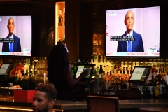 Former U.S. President Barack Obama is seen on television screens as he speaks during the third day of the Democratic National Convention, being held virtually amid the novel coronavirus pandemic, at The Abbey bar and restaurant in West Hollywood, Calif. (Photo credit: ROBYN BECK/AFP via Getty Images)