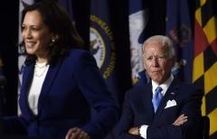 Joe Biden listens as his vice presidential running mate, Sen. Kamala Harris, speaks in Wilmington, Delaware, on Wednesday. (Photo by Olivier Douliery/AFP via Getty Images)
