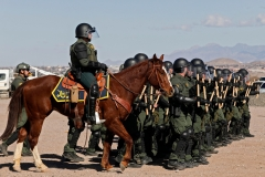 U.S. Border Patrol agents conduct a training exercise in the Anapra area, in front of the wall that divides Sunland Park, New Mexico, US, from Mexico, as seen from Ciudad Juarez, Chihuahua state, on Jan. 31, 2020.