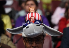 A Hillary Clinton supporter wears a donkey hat with a Hillary doll on Day 3 of the Democratic National Convention at the Wells Fargo Center, July 27, 2016 in Philadelphia, Penn. (Photo credit: TIMOTHY A. CLARY/AFP via Getty Images)