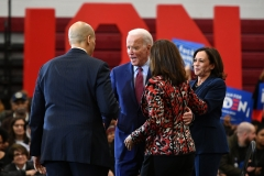 Democratic presidential candidate Joe Biden (C) greets New Jersey Senator Cory Booker (L) as California Senator Kamala Harris (L) and Michigan Governor Gretchen Whitmer (R) cheer during a campaign rally at Renaissance High School in Detroit, Michigan on March 9, 2020. (Photo credit: MANDEL NGAN/AFP via Getty Images)
