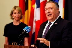 Secretary of State Mike Pompeo, flanked by U.S. Ambassador to the U.N. Kelly Craft, speaks at the U.N. on Thursday on the Iran sanctions 'snapback' initiative.  (Photo by Mike Segar/Pool/AFP via Getty Images)