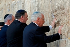 Secretary of State Mike Pompeo prays at the the Western Wall in Jerusalem's Old City during a previous visit. With him are Israeli Prime Minister Binyamin Netanyahu and U.S. Ambassador to Israel David Friedman. (Photo by Jim Young/Pool/AFP via Getty Images)