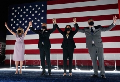 All wearing big, black masks, the Bidens join Kamala Harris and her husband Douglas Emhoff on stage at the Chase Center in Wilmington, Delaware, at the conclusion of the Democratic National Convention on August 20, 2020. (Photo by OLIVIER DOULIERY/AFP via Getty Images)