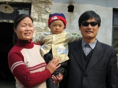 A picture dated March 2005 shows Chen Guangcheng with his wife and son outside their home in Shandong province. (Photo by STR/AFP via Getty Images)