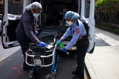 EMTs sanitize a hospital gurney after dropping off a patient at a Brooklyn hospital. (Photo by Robert Nickelsberg/Getty Images)
