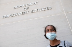 A woman stands outside the D.C. Department of Employment Services on July 16, 2020 after trying to find out about her unemployment benefits. (Photo by SAUL LOEB/AFP via Getty Images)
