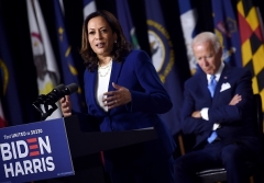 Democratic presidential candidate Joe Biden listen to his vice presidential running mate Sen. Kamala Harris speak during their first press conference together in Wilmington, Delaware, on August 12, 2020. (Photo by Olivier DOULIERY/AFP via Getty Images)