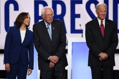 Sens. Kamala Harris, Bernie Sanders,and former Vice President Joe Biden at the fourth Democrat primary debate of the 2020 presidential campaign season in Westerville, Ohio on October 15, 2019. (Photo by SAUL LOEB/AFP via Getty Images)