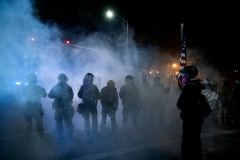 Tear gas fills the air in Portland, Oregon, as protests, often violent or destructive, enter a third month. (Photo by ALISHA JUCEVIC/AFP via Getty Images)
