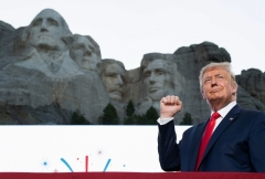 President Donald Trump pumps his fist as he arrives for the Independence Day events at Mount in Keystone, South Dakota, July 3, 2020. (Photo by SAUL LOEB/AFP via Getty Images)