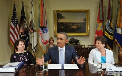 U.S. President Barack Obama meets with business leaders on immigration reform on June 24, 2013 in the Roosevelt Room of the White House in Washington, DC. Flanking Obama are White House Director of Domestic Policy Council Cecilia Munoz (L) and senior advisor to the president Valie Jarrett. (Photo credit: MANDEL NGAN/AFP via Getty Images)