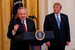 President Donald Trump listens as Interior Secretary David Bernhardt speaks about the administration's environmental policies at the White House in Washington, DC on July 8, 2019. (Photo credit should read NICHOLAS KAMM/AFP via Getty Images)