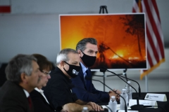 California Governor Gavin Newsom(top) D-CA speaks during a briefing on wildfires with local and federal fire and emergency officials at Sacramento McClellan Airport in McClellan Park, California on September 14, 2020. (Photo by BRENDAN SMIALOWSKI/AFP via Getty Images)
