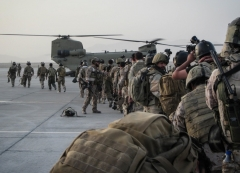 U.S. special forces soldiers prepare to board CH-47 Chinook helicopters in Afghanistan's Helmand province. (Photo: (U.S. Army/Sgt. Connor Mendez)