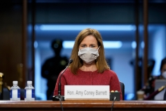 Supreme Court nominee Amy Coney Barrett listens during a confirmation hearing before the Senate Judiciary Committee. (Photo credit: SUSAN WALSH/POOL/AFP via Getty Images)