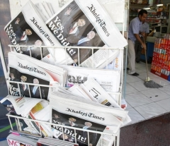 Headlines in newspapers in Dubai report on the Obama-Biden election victory in Nov. 2008. A new poll finds a majority of Arabs think their administration left the region worse off. (Photo by Karim Sahib/AFP via Getty Images)