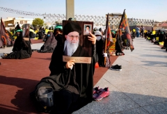Men hold pictures of the Iranian Supreme Leader Ayatollah Ali Khamenei , during a protest against the reprinting of the cartoon of the Prophet Mohammad by French magazine Charlie Hebdo, at the Imam Hussein square in the capital Tehran, on September 10, 2020. (Photo by AFP via Getty Images)
