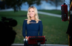 """White House Press Secretary Kayleigh McEnany speaks during a television interview at the White House in Washington, DC, October 2, 2020. - Donald Trump's chief of staff said October 2, 2020 the president was experiencing """"mild symptoms"""" of Covid-19, after the bombshell news of his infection upended the White House race a month before the Republican faces challenger Joe Biden at the polls. (Photo by SAUL LOEB/AFP via Getty Images)"""