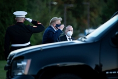 President Donald Trump (C) walks off Marine One while arriving at Walter Reed Medical Center in Bethesda, Maryland on October 2, 2020, after testing positive for covid-19. - President Donald Trump will spend the coming days in a military hospital just outside Washington to undergo treatment for the coronavirus, but will continue to work, the White House said Friday. (Photo by BRENDAN SMIALOWSKI/AFP via Getty Images)