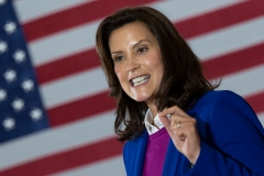 """Michigan Governor Gretchen Whitmer introduces Democratic Presidential Candidate Joe Biden to speak at Beech Woods Recreation Center in Southfield, Michigan, on October 16, 2020. - Joe Biden on October 16, 2020 described President Donald Trump's reluctance to denounce white supremacists as """"stunning"""" in a hard-hitting speech in battleground Michigan with 18 days to go until the election. (Photo by JIM WATSON/AFP via Getty Images)"""