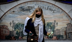 A woman wearing a face mask to protect against the coronavirus disease walks out of an underground crossing at Tverskaya metro station in central Moscow on October 26, 2020. (Photo by YURI KADOBNOV/AFP via Getty Images)