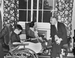 President Roosevelt talks to Renee Daly from Spring Valley, New York and Jerry Gould from Scranton, Pennsylvania. Roosevelt was the guest of honor at a luncheon given at the Warm Springs Foundation.