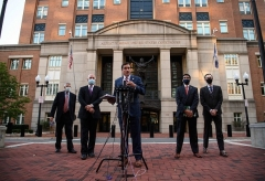 U.S. Attorney G. Zachary Terwilliger, flanked by colleagues, speaks to the press outside the U.S. District Court in Alexandria, Virginia, on Wednesday after the first hearing of the two ISIS jihadists. (Photo by Nicholas Kamm/AFP via Getty Images)