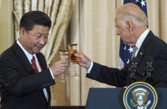 Vice President Joe Biden toasts Chinese President Xi Jinping in 2015. (Photo by Paul J. Richards/AFP via Getty Images)