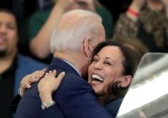 Sen. Kamala Harris hugs former Vice President Joe Biden in Detroit, Mich., March 9, 2020. (Photo by Scott Olson/Getty Images)