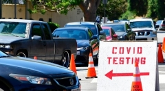 Motorists line up for coronavirus testing in Los Angeles in June.  (Photo by Frederic J. Brown/AFP via Getty Images)