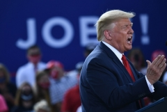 President Donald Trump delivers remarks on the economy at an airport hanger in Oshkosh, Wisconsin on August 17, 2020. (Photo by BRENDAN SMIALOWSKI/AFP via Getty Images)