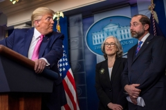President Donald Trump turns to address Secretary of Health Alex Azar as he speaks during a news conference on the COVID-19 outbreak at the White House. (Photo credit: ERIC BARADAT/AFP via Getty Images)