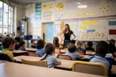 A teacher addresses the class. (Photo credit: MARTIN BUREAU/AFP via Getty Images)