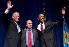 Chris Coons with then-President Obama and Vice President Joe Biden in 2010. (Photo by Saul Loeb/AFP via Getty Images)