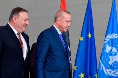 Secretary of State Mike Pompeo and Turkish President Recep Tayyip Erdogan in Berlin last January. (Photo by Tobias Schwartz/AFP via Getty Images)