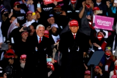 President Donald Trump and Vice President Mike Pence stand on stage at the end of the final Make America Great Again rally of the 2020 US Presidential campaign at Gerald R. Ford International Airport on November 2, 2020, in Grand Rapids, Michigan. (Photo by JEFF KOWALSKY/AFP via Getty Images)