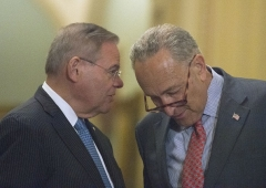 Sen. Bob Menendez, D-N.J., speaks to Minority leader Chuck Schumer on Capitol Hill. (Photo by Andrew Caballero-Reynolds/AFP via Getty Images)