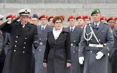 German Defence Minister Annegret Kramp-Karrenbauer inspects army recruits in Berlin. (Photo by Tobias Schwarz/AFP via Getty Images)