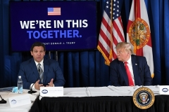 President Donald Trump and Florida Gov. Ron DeSantis discussed the pandemic in Belleair, Florida, July 31, 2020. (Photo by SAUL LOEB/AFP via Getty Images)
