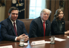 President Trump with Florida Gov. Ron DeSantis and South Dakota Gov. Kristi Noem. (Photo by Mark Wilson/Getty Images)
