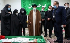 Iranian judiciary chief Ayatollah Ebrahim Raisi and others with the body of slain nuclear scientist Mohsen Fakhrizadeh. (Photo by Mizan News Agency/AFP via Getty Images)