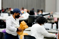 Election workers count absentee ballots in Detroit, Michigan. (Photo by Jeff Kowalsky/AFP via Getty Images)