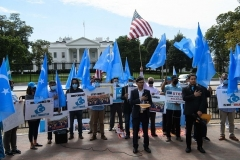 Uyghurs hold a rally near the White House in October to protest the 71st anniversary of the People's Republic of China. (Photo by Nicholas Kamm/AFP via Getty Images)