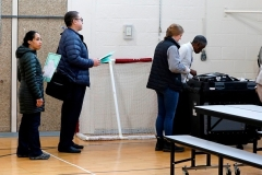 People wait to insert their ballots in a tabulation machine in Detroit, Michigan, on March 10, 2020. (Photo by JEFF KOWALSKY/AFP via Getty Images)