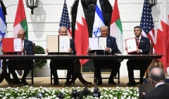 President Trump, Israeli Prime Minister Binyamin Netanyahu, UAE Foreign Minister Abdullah bin Zayed al-Nahyan, and Bahraini Foreign Minister Abdullatif al-Zayani at the White House signing ceremonies on September 15. (Photo by Saul Loeb/AFP via Getty Images)