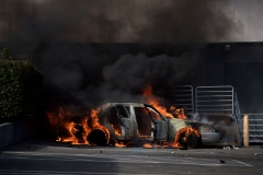 A car in flames is pictured during a demonstration over the death of George Floyd while in Minneapolis Police custody, in Santa Monica, Calif., on May 31, 2020. (Photo credit: AGUSTIN PAULLIER/AFP via Getty Images)