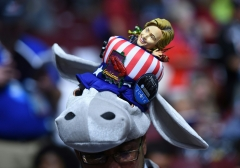 Pictured is a hat featuring the Democratic donkey and a Hillary Clinton figurine head. (Photo credit: TIMOTHY A. CLARY/AFP via Getty Images)